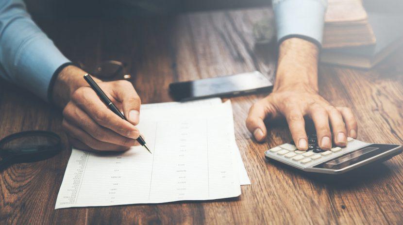 Man doing a Lemon law buyback calculation